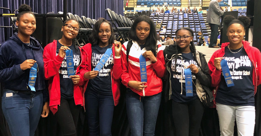 Alain Locke Charter School students display their Blue Ribbon awards from the Illinois History Day competition in Springfield