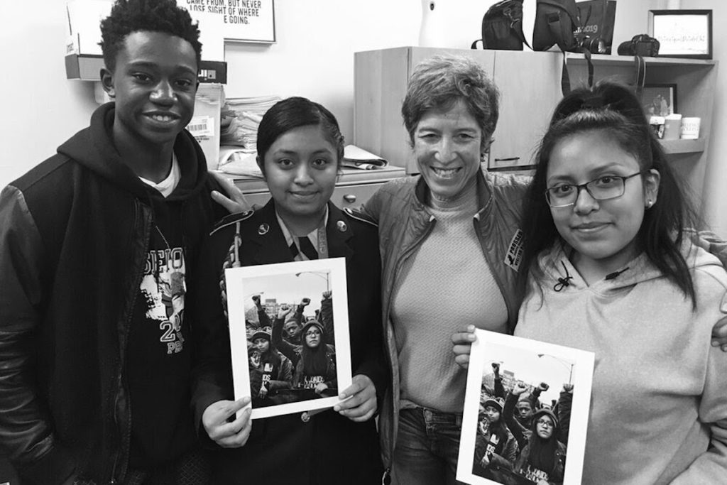 Steinbrecher poses with the activists she photographed in 'Frontline, March for Our Lives, Chicago'