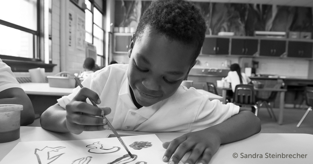 Alain Locke Charter School student working on a painting