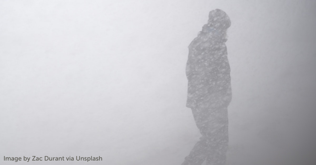 Person walks outside during snowstorm